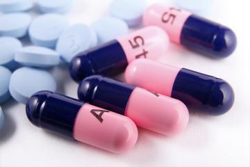 Generic antibiotic capsules and pain reliever pills