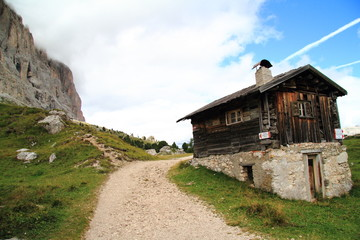 View of mountain path to reach Comici refuge, with a old barn