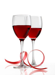 Glass of red wine on a white background and with soft shadow