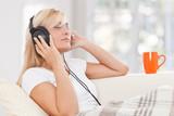 Beauty, blondie woman listening music with earphones