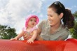Baby Girl Plays with Mum in Playground