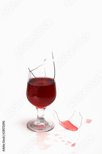 broken glass with wine and drops