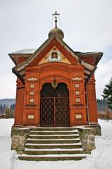 Brick-red ortodox church