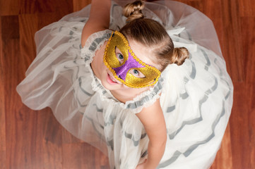Little girl on masquerade