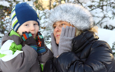 Portrait of young mum with the son in the winter on walk