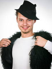 trendy young man closed into the fur vest