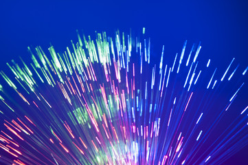 Fiber optics background with lots of light spots .