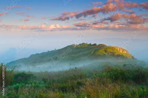 Landscape of misty mountain at sunrise