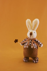 Fluffy textile rabbit with flower