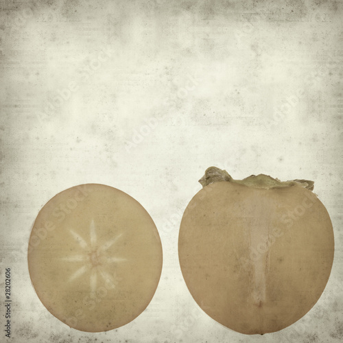 textured old paper background with persimmon fruit