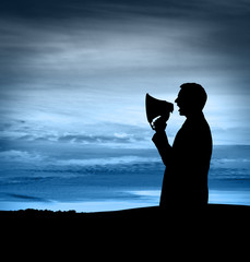 Silhouette of man with Megaphone