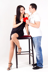 a man giving a gift to a beautiful girl, heart box,  love, happi