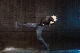 Kicking dancer in aqua studio