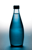 bottle with cold purified mineral water on the ice surface poster