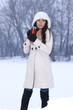 Girl with thermal mug in snowy outdoor