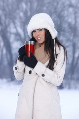 Caucasian beauty sticks in her hand thermal mug