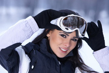 Female snowboarder standing on snowy outdoors