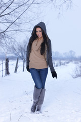 Georgeous woman standing on snowy outdoor