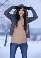 Woman weraing warm hooded sweatshirt