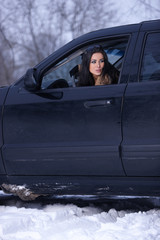 Woman in her 4x4 car on snowy outdoor terrain
