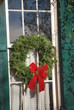Christmas wreath on window of historic house
