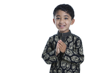 Smiling Toddler with Folded Hands Signifying Traditional Indian
