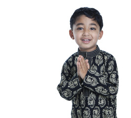 Indian Toddler with Folded Hands Greeting Signifying Traditional