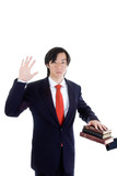 Asian Man Swearing on a Stack of Bibles Isolated White poster
