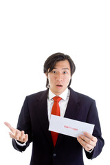 Shocked Asian Man Holding a Foreclosure Notice Envelope Isolated