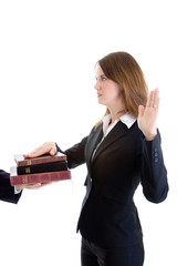 Caucasian Woman Suit Swearing on a Stack of Bibles Isolated