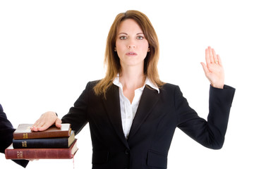 Caucasian Woman Swearing on a Stack of Bibles White Background