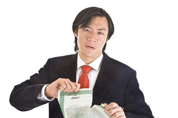 Unhappy Asian Man Tearing Stock Certificate, Isolated Background