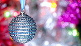Beautiful Christmas ball over blurred flickering background