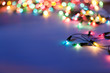 Christmas lights on dark blue background with copy space. Decora - 28222682