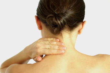 Woman massaging neck, isolated