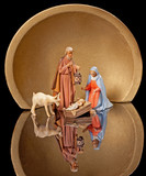 Christmas Nativity with Joseph Holding Lantern in Manger