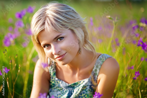 girl smiles on meadow