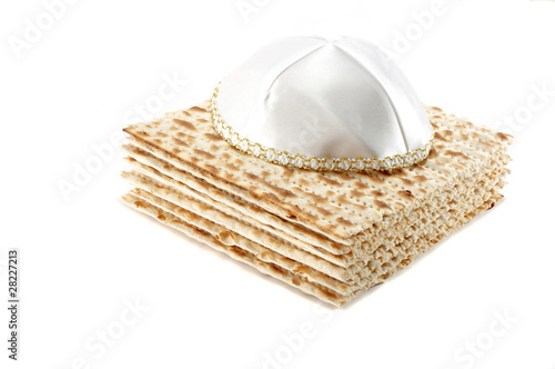 Jewish Passover holiday still life with matzoh and kippah on whi