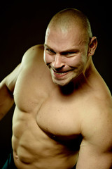 Emotional portrait of muscular aggressive man