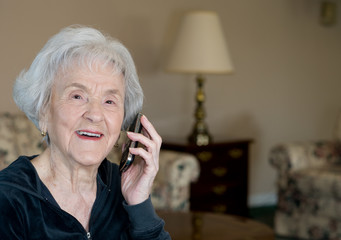 Elderly Woman on Blackberry  Smiling