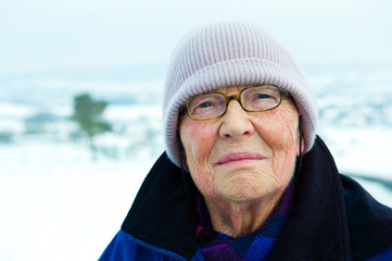 old woman in winter landscape