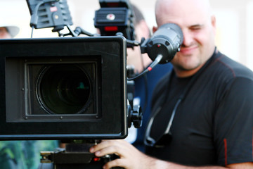 Man with digital cinema camera on movie set