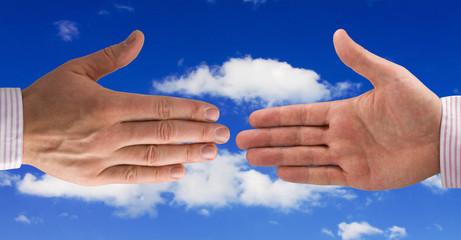 Handshake of businessmen. isolated on sky background