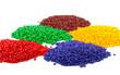 Leinwandbild Motiv Colourful plastic polymer granules