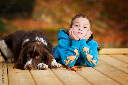 little boy and his pet dog