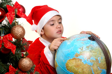 The boy in a suit of Santa Claus  with the globe