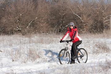 Smiling snow biker