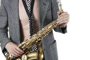 The young jazzman with a saxophone