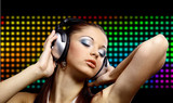 Fototapety Portrait of a young dancing girl in headphones