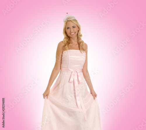 A young and beautiful blond Caucasian princess in white clothes